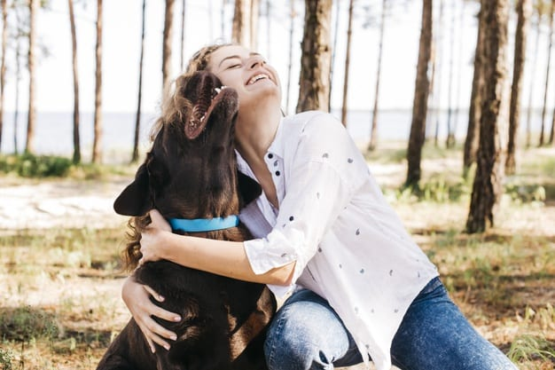 young-woman-doing-picnic-with-her-dog